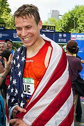 UAE Healthy Kidney 10K, Ben True, draped in American flag, happy after sinning race
