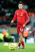 Liverpool defender Trent Alexander-Arnold (66) warming up during the Premier League match between Liverpool and Everton at Anfield, Liverpool, England on 4 December 2019.