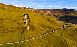 "Spittal of Glenshee, Scotland, UK. 18th November 2019. View of a giant portrait of Blairgowrie poet Hamish Henderson sculpted onto a Perthshire hillside to commemorate the folk legend and launch the Cateran Ecomuseum. The 175m long temporary sculpture made from jute by local artist Martin McGuiness is called ""Come aa ye at hame wi Freedom"" and celebrates 100 years since the poet's birth.The Cateran Ecomuseum is a new outdoor museum featuring attractions across Perthshire and west Angus. The sculpture is visible until 8th December 2019. Iain Masterton/Alamy Live News."