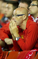 LIVERPOOL, ENGLAND - Tuesday, August 27, 2013: A pensive Liverpool supporter against Notts County during the Football League Cup 2nd Round match at Anfield. (Pic by David Rawcliffe/Propaganda)