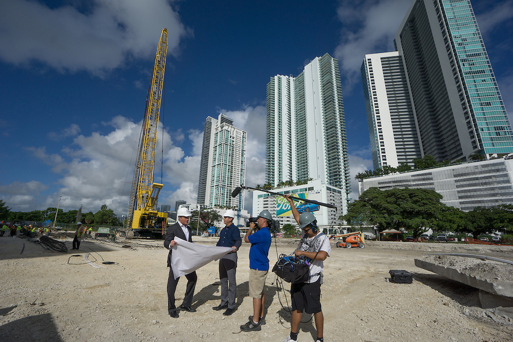 MIAMI,  FLORIDA--- NOVEMBER 3, 2015: <br /> Daniel Kodsi, left, Developer and CEO of Paramount Miami Worldcenter looks at plans for the project  near equipment and construction workers on the grounds of what will become Paramount Miami Worldcenter in downtown Miami. The 60 story condo tower with 470 residences will sit atop the the Miami Worldcenter Mall. A video crew is recording them. (Photo by Angel Valentin)