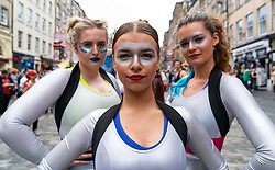 Edinburgh, Scotland, UK; 5 August, 2018. Edinburgh Fringe Festival's first weekend sees thousands of tourists and locals on the Royal Mile  enjoying the free street performers. Pictured; Saucy Jack and the Space Vixens.