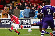 Ebbsfleet United forward Darren McQueen (16) scores 6-1 during the Vanarama National League South match between Ebbsfleet United and East Thurrock United at the Enclosed Ground, Whitehawk, United Kingdom on 4 March 2017. Photo by Jon Bromley.
