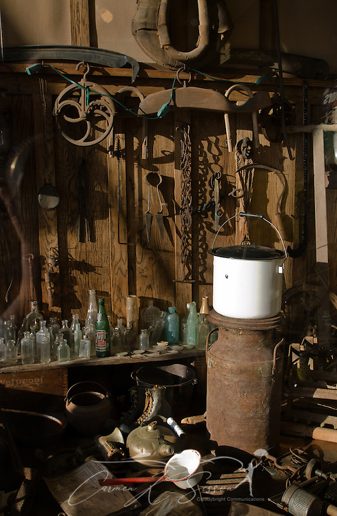 Farm implements, enamelware, and old bottles sit in a window at Booker Hardware & Cutlery Oct. 10, 2011 in Holly Springs, Miss. The store was established in 1937. (Photo by Carmen K. Sisson/Cloudybright)