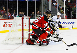 Dec 10, 2008; Newark, NJ, USA; New Jersey Devils center Bobby Holik (16) skates with the puck after a save by New Jersey Devils goalie Scott Clemmensen (35) during the third period at the Prudential Center. The Devils defeated the Penguins 4-1.
