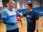 12 DECEMBER 2019 - DES MOINES, IOWA: J.D. SCHOLTEN, left, and ANDREW YANG chat after a basketball game in the gym in the Ames, IA, City Hall. Scholten is an Iowa Democrat running against Republican Congressman Steve King. Yang, an entrepreneur, is running for the Democratic nomination for the US Presidency in 2020. He brought bus tour to Ames, IA, Thursday. Iowa hosts the the first election event of the presidential election cycle. The Iowa Caucuses will be on Feb. 3, 2020.        PHOTO BY JACK KURTZ