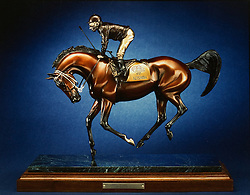 Bronze sculpture of Alysheba by Cindy Wolf. This photo is of a Cibachrome print Wolf has in an album of her work. She does not have any of these prints digitized therefore this photo was made to show her work. <br /> <br /> Gifted Artist for Keeneland Magazine Winter Issue, Cindy Wolf was photographed,Saturday, Oct. 13, 2012 at Cindy Wolf Studio/Home in Versailles . Photo by Jonathan Palmer