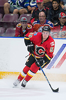 PENTICTON, CANADA - SEPTEMBER 16: Dillon Dube #59 of Calgary Flames stops on the ice with the puck <br /> against the Winnipeg Jets on September 16, 2016 at the South Okanagan Event Centre in Penticton, British Columbia, Canada.  (Photo by Marissa Baecker/Shoot the Breeze)  *** Local Caption *** Dillon Dube;