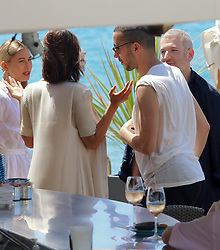 Bella Hadid seen friendly with an unidentified man on the beach in Cannes. 17 May 2017 Pictured: Bella Hadid. Photo credit: Oliver Palombi / MEGA TheMegaAgency.com +1 888 505 6342