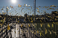 Ahead of Catalan Regional Election, yellow ribbons hang on a wire fence in support of independentists politicians sent to jail after Catalonia's government was dismissed by Madrid. 17 December 2017.