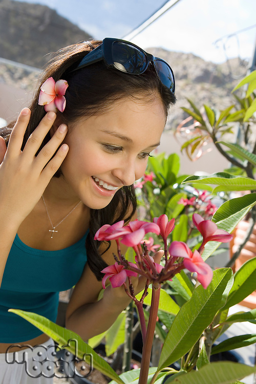 Pretty Young Woman Smelling Flowers