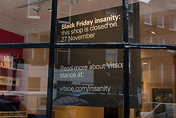 "© Licensed to London News Pictures. 24/11/2015. London, UK. A sign displayed in the window of furniture retailer, Vitsoe in Duke Street, near Oxford Street stating that the shop will be closed on Black Friday, 27th November. Vitsoe will close all its branches on Black Friday, calling it ""Black Friday insanity"". Photo credit : Vickie Flores/LNP"