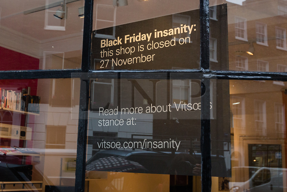 """© Licensed to London News Pictures. 24/11/2015. London, UK. A sign displayed in the window of furniture retailer, Vitsoe in Duke Street, near Oxford Street stating that the shop will be closed on Black Friday, 27th November. Vitsoe will close all its branches on Black Friday, calling it """"Black Friday insanity"""". Photo credit : Vickie Flores/LNP"""