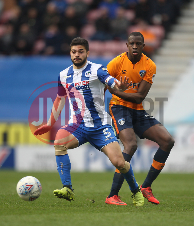 Sam Morsy of Wigan Athletic (L) and Ousmane Fane of Oldham Athletic in action - Mandatory by-line: Jack Phillips/JMP - 30/03/2018 - FOOTBALL - DW Stadium - Wigan, England - Wigan Athletic v Oldham Athletic - Football League One