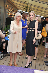 Left to right, HRH The DUCHESS OF CORNWALL and ALANNAH WESTON at a party to celebrate the publication on 'Let's Eat: Recipes From My Kitchen Notebook' by Tom Parker Bowles held at Selfridge's Rooftop. Selfridge's, Oxford Street, London on 27th June 2012.