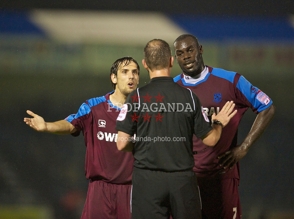 BRISTOL, ENGLAND - Tuesday, September 28, 2010: Tranmere Rovers' Maximo Blanchard (L) and Enoch Showunmi complain to referee Chris Sarginson during the Football League One match against Bristol Rovers at the Memorial Ground. (Photo by David Rawcliffe/Propaganda)