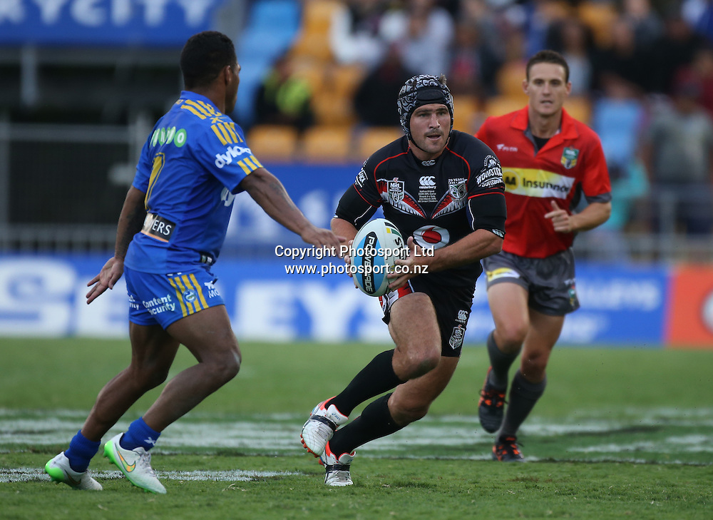 NZ Warriors player Nathan Friend makes a break during  the NRL Rugby League match between the NZ Warriors and the Parramatta Eels played at Mt Smart Stadium in South Auckland on the 21st March 2015. <br /> <br /> Copyright Photo; Peter Meecham/ www.photosport.co.nz