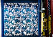 Lyon, Atelier Hermès, silk atelier at Pierre-Benite,  un quadro di stampa utilizzato per la creazione dei carré. Ogni quadro rappresenta uno dei colori del carré. Il disegno viene riportato sulla tela del quadro per insolazione diretta, con fasci di luce. print tableau, used to create the famous carré. every tableau reprents one color of the scarf
