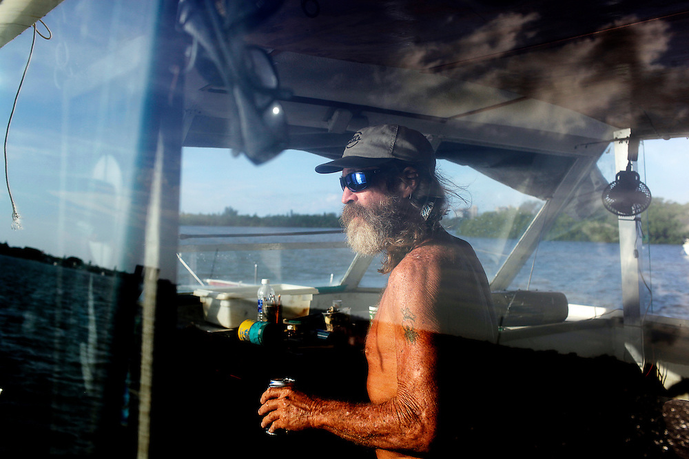 """""""For the most part, we have our freedom,"""" Randy Eibler said on his houseboat anchored in Estero Bay, Fla. Eibler, 55, said he has been living on a boat since he was 21 years old."""