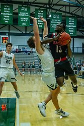 BLOOMINGTON, IL - November 12: Grant Wolfe takes one just below the chin from Nigel Ferrell during a college basketball game between the IWU Titans  and the Blackburn Beavers on November 12 2019 at Shirk Center in Bloomington, IL. (Photo by Alan Look)