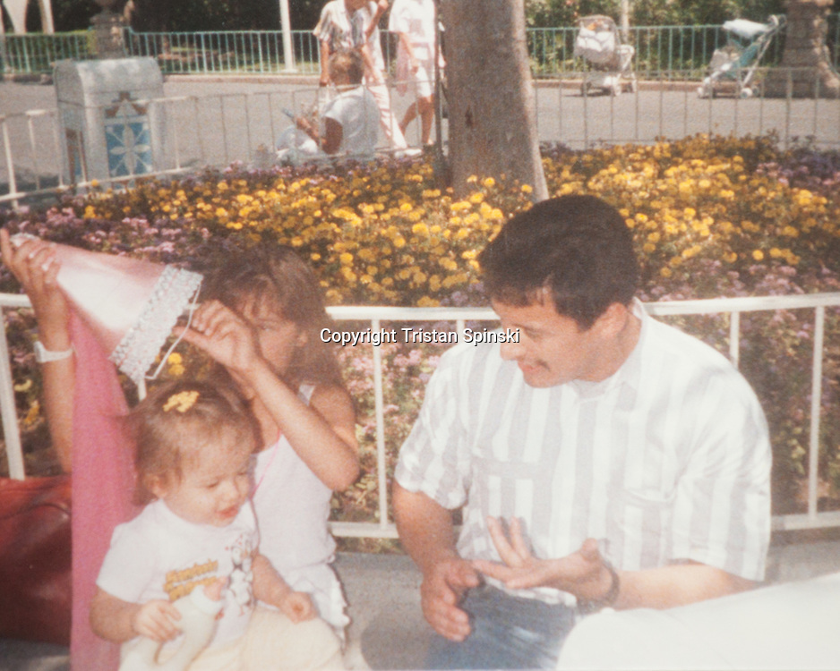 Photograph of Donald Martinez, right, and his infant daughter, Tiffany, at Disneyland. Tiffany, now a Family Psychiatric Mental Health Nurse Practitioner, began exhibiting symptoms of schizophrenia, a condition her father suffers from, several years ago. She no longer takes anti-psychotic medications and is symptom free, which she credits to therapy, stress reduction, exercises in mindfulness, physical activity, and changes in diet.