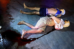 October 4, 2016 - Philippines - (EDITOR'S NOTE: Image contains graphic content)Two un-identified allegedly drug dealers are the victims of summary executions at the front of Santa Catalina Colleges, Legarda, Manila City. (Credit Image: © Gregorio B. Dantes Jr/Pacific Press via ZUMA Wire)