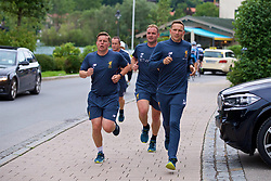 ROTTACH-EGERN, GERMANY - Thursday, July 27, 2017: Liverpool's first-team development coach Pepijn Lijnders and staff run back from training from the Seehotel Uberfahrt on the banks of Lake Tegernsee on day two of their preseason training camp in Germany. (Pic by David Rawcliffe/Propaganda)