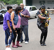 Sister Sohjah (right) dances before the start of a Moving in Peace motorcade thru all of Camden's neighborhoods to recognize and honor the victims of violence in the city Saturday, August 12, 2017 at Farnham Park in Camden, New Jersey. (WILLIAM THOMAS CAIN / For The Philadelphia Inquirer)