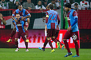 Trabzonspor's Florent Malouda and Olcan Adin celebrate goal for Trabzonspor during the UEFA Europa League Group J football match between Legia Warsaw and Trabzonspor AS at Pepsi Arena Stadium in Warsaw on November 07, 2013.<br /> <br /> Poland, Warsaw, November 07, 2013<br /> <br /> Picture also available in RAW (NEF) or TIFF format on special request.<br /> <br /> For editorial use only. Any commercial or promotional use requires permission.<br /> <br /> Mandatory credit:<br /> Photo by © Adam Nurkiewicz / Mediasport