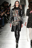 Yue Ning walks the runway wearing Custo Barcelona Fall 2016 20th Anniversary Collection during New York Fashion Week on February 14, 2016