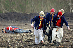 11 January 2015. New Orleans, Louisiana. <br /> Bicentennial reenactment of the Battle of New Orleans in Chalmette. <br /> British troops are 'gunned down' as they re-enact their disastrous January 8th, 1815  battle against American foes marking the 200th anniversary of the Battle of New Orleans in Chalmette. Despite heavily outnumbering the Americans, the British suffered over 2,000 casualties, with many senior officers amongst the dead and injured compared to the Americans who suffered a mere 70 by comparison. The American victory was hailed as miracle.<br /> Photo; Charlie Varley/varleypix.com