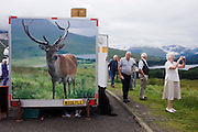 The image of a once-famous stag who used to be fed by tourists and the owner of the Oasis cafe on the A82 on Rannoch Moor but shot many times with an air gun by juvenile New Year revellers. Looking out onto the moors it roamed in life, the deer named Big Boy by locals had an insatiable appetite for scraps from outdoor snack bar owner MacDonald and his customers, the stag inched ever closer to the migrant humanity alongside the road. So locally famous did he become that one Hogmanay, the beast was shot several times by air gun-toting juveniles and is now a tragic, posthumous print on the same tourist cafe trailer. Now holidaymakers, unaware of the animal's life and death near this spot, merely stop to photograph the scenery in the hope of seeing the nearby herd that Big Boy ruled over.