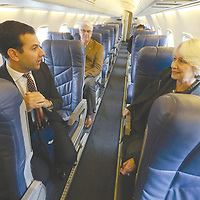 Matt Chaifetz, left, chats with Hannah Stanley as Contour Airlines shows off an ERJ-135 that will begin jet service in April from Tupelo to Nahsville.