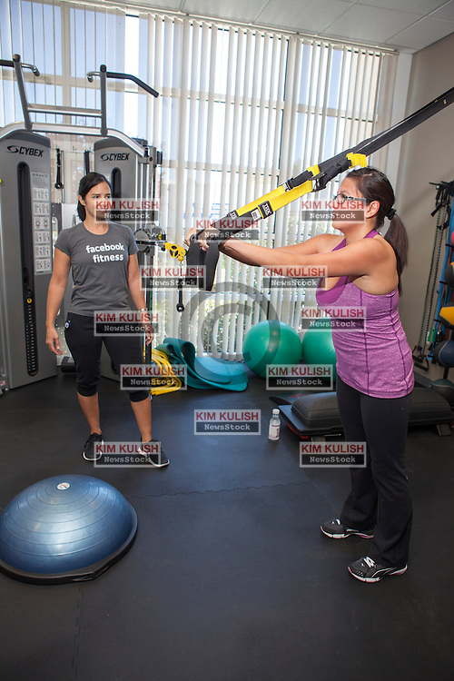 Scenes of daily work and life at Facebook', Inc. USA Headquarters in Menlo Park, California.  The Facebook gym offers machines and personal training.