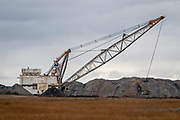 The Big Lou excavator digs out coal from the coal day mine next to the SASK Power Plant. The Canadian Sask Power Plant Boundary Dam claims to be the worlds first coal power plant with viable carbon capture and storage incorporated.