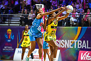 Jamaican goal attack Shanice Beckford takes a pass under Fijian pressure in the second half during the 2019 Netball World Cup match between Jamaica and Fiji at M & S Bank Arena, Liverpool, United Kingdom on 12 July 2019.