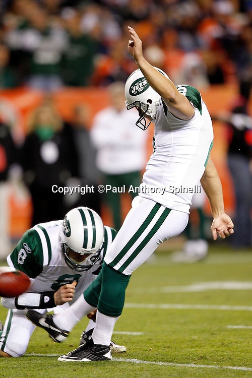 New York Jets kicker Nick Folk (2) kicks an extra point PAT that gives the Jets a 10-3 lead during the NFL week 11 football game against the Denver Broncos on Thursday, November 17, 2011 in Denver, Colorado. The Broncos won the game 17-13. ©Paul Anthony Spinelli