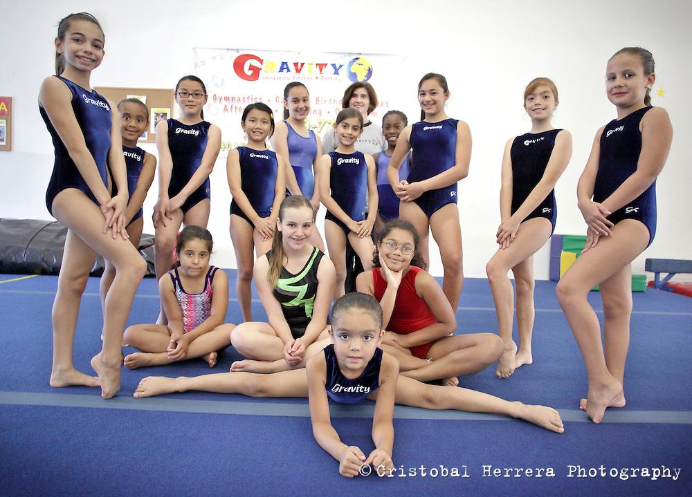 Girls attend their training session at Gravity Gymnastics, in Miramar on April 6, 2012. Photo: Cristobal Herrera