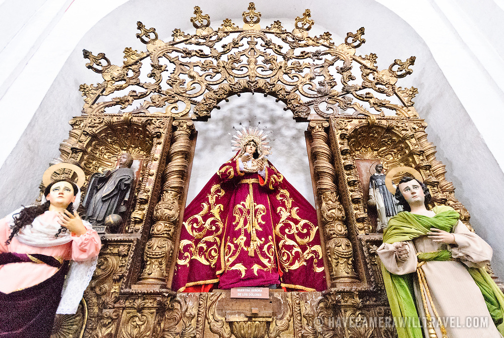 An altar dedicated to Our Lady of Guadalupe at Iglesia de San Francisco in Antigua, Guatemala.