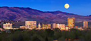 Idaho. Downtown Boise skyline at twilight with full moon over foothills.