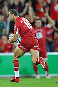 """Quade Cooper races towards the line to score for the Reds during action from the Super 15 Rugby Union match played between the Queensland Reds and the NSW Waratahs at Suncorp Stadium (Brisbane, Australia) on Saturday 23rd April 2011<br /> <br /> Conditions of Use : NO AGENTS ~ This image is intended for Editorial use only (news or commentary, print or electronic) - Required Images Credit """"Steven Hight - Aura Images"""""""