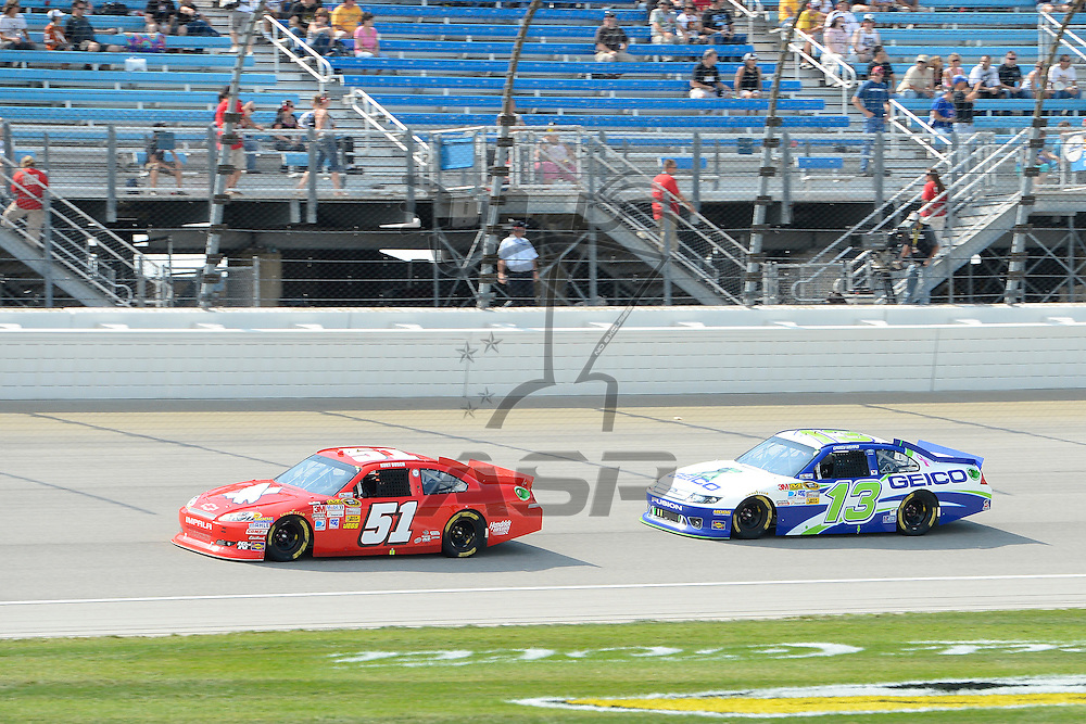 Joliet, IL - SEP 16, 2012: Kurt Busch (51) and Casey Mears (13) races during the Geico 400 at the Chicagoland Speedway in Joliet, IL.