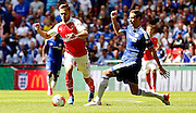 Aaron Ramsey avaids the challenge from Nemanja Matic during the FA Community Shield match between Chelsea and Arsenal at Wembley Stadium, London, England on 2 August 2015. Photo by Michael Hulf.