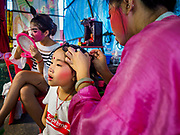 26 AUGUST 2018 - GEORGE TOWN, PENANG, MALAYSIA: A child gets help with her hair and makeup before a Hokkien style Chinese opera on the Lim Jetty in George Town for the Hungry Ghost Festival. The opera troupe came to George Town from Fujian province in China. The Hungry Ghost Festival is a traditional Buddhist and Taoist festival held in Chinese communities throughout Asia. The Ghost Festival, also called Ghost Day, is on the 15th night of the seventh month (25 August in 2018). During the Hungry Ghost Festival, the deceased are believed to visit the living. In many Chinese communities, there are Chinese operas and puppet shows and elaborate banquets are staged to appease the ghosts.     PHOTO BY JACK KURTZ