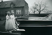 Brides maids following the brides and grooms wedding car