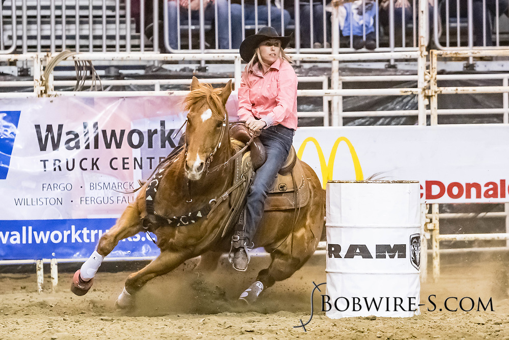 Ginger LaDuke makes her barrel run at the Bismarck Rodeo on Friday, Feb. 2, 2018. She ran a 13.28.