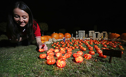 Model maker Melissa Maughan places a jack-o-lantern from the new pumpkin patch at Legoland Windsor Resort in Miniland, ahead of their Halloween 'brick or treat' season.