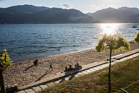 VERBANIA, ITALY - 18 APRIL 2017: A family relaxes by the Lake Maggiore in Verbania, Italy, on April 18th 2017.<br /> <br /> Emma Morano was an Italian supercentenarian who, prior to her death at the age of 117 years and 137 days, was the world's oldest living person whose age had been verified, and the last living person to have been verified as being born in the 1800s. She died on April 15th 2017.