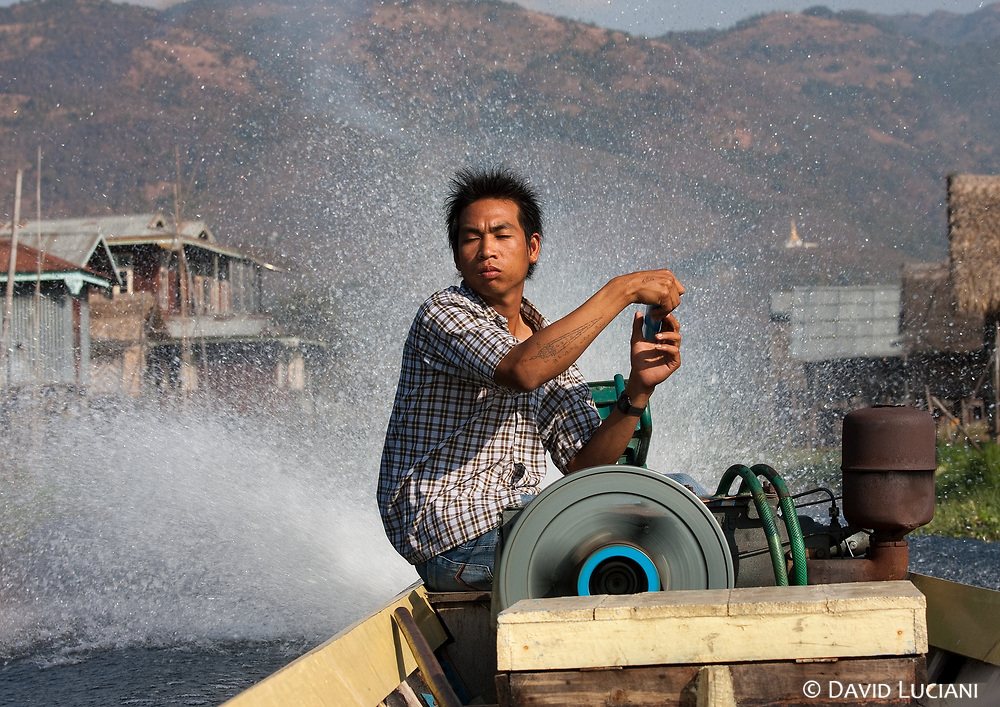 Our boatman steering his speedboat back to our guesthouse in Nyaung Shwe.