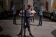 Smoking employees enjoy cigarettes and autumn sunshine <br /> in Leadenhall Street, on 12th September, in the City of London, UK.